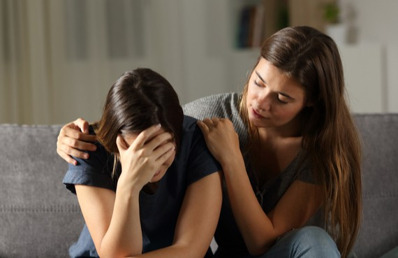 Woman consoles a friend after a suicide