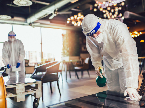 workers decontaminating a restaurant