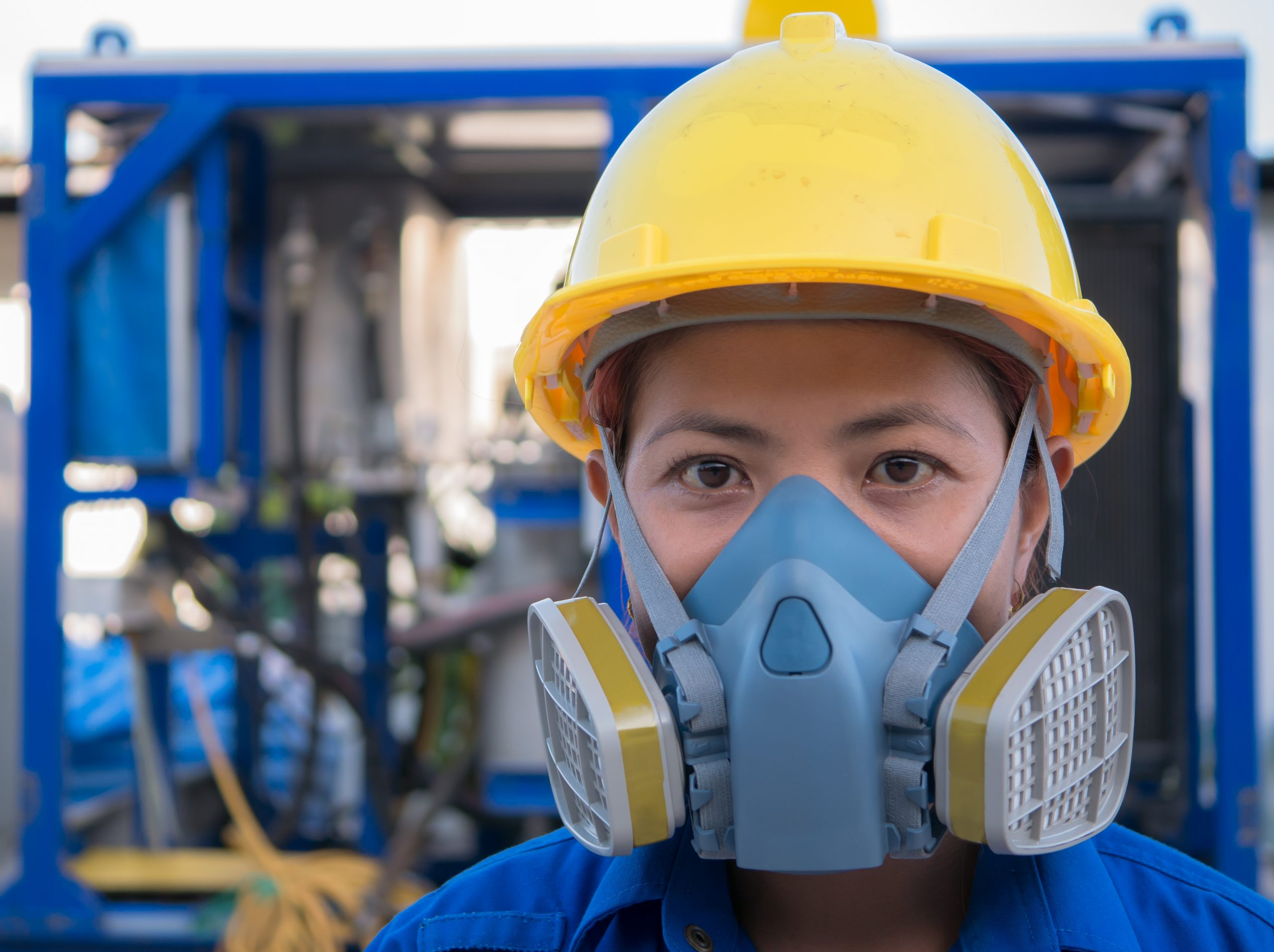 female industrial worker wearing a facemask